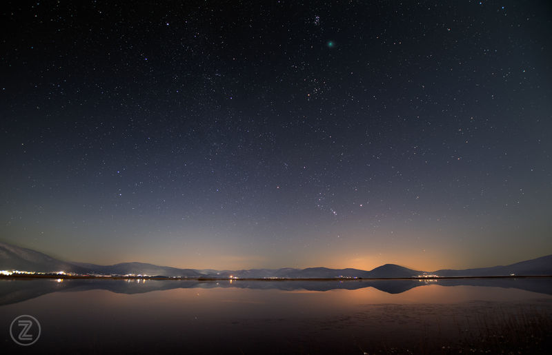 Landscape shot with Cerknica lake and Wirtanen approaching Pleiades