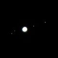 The planet Jupiter's four largest moons and these large moons, named Io, Europa, Ganymede, and Callisto.