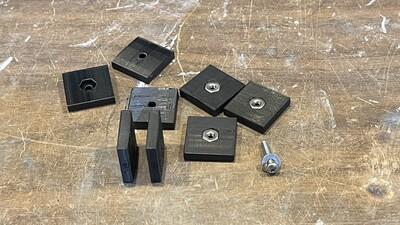 Tube backer nut holders for rotating ring bolts