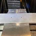 Finished adapter plate with CNC drilled bolt pattern attached to radius blocks
