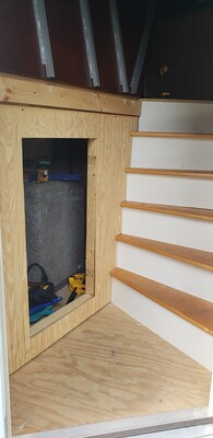 Storage door cutout to access electrical under flooring