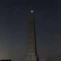 Eclipsed Moon at totality over the monument