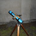 Keplerian refractor 15mm F/32 at 9x -built in