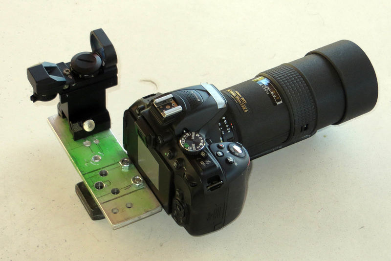camera mounted with anto-rotation plate and red dot finder