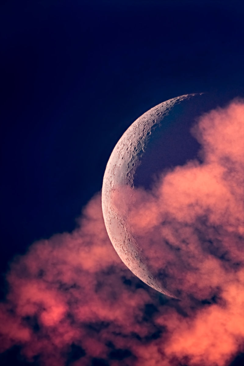crescent moon clouds sunset